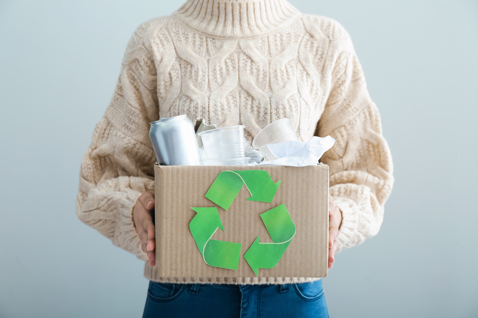Picture of woman holding recyclables